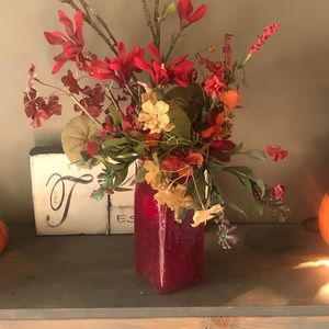 Red glass vase and flowers